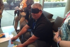 blindfolded DG Evan following instruction from multiple Lions